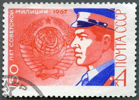 militia: USSR - CIRCA 1967: A stamp printed in USSR dedicate 50th anniversary of the Soviet Militia, shows Militiaman and Soviet Emblem, circa 1967