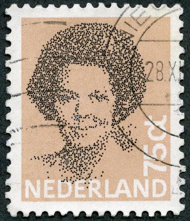 postal: NETHERLANDS - CIRCA 1981: A stamp printed in Netherlands shows Queen Beatrix, Black Vignette, circa 1981