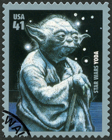 UNITED STATES OF AMERICA - CIRCA 2007: A stamp printed in USA shows portrait of Yoda, series Premiere of Movie Star Wars 30 anniversary, circa 2007 Editorial
