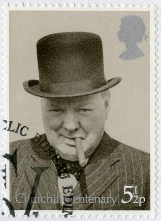 winston: UNITED KINGDOM - CIRCA 1974: A stamp printed in United Kingdom shows Sir Winston Spencer Churchill (1874-1965), with bowler and cigar, 1940, politician, circa 1974