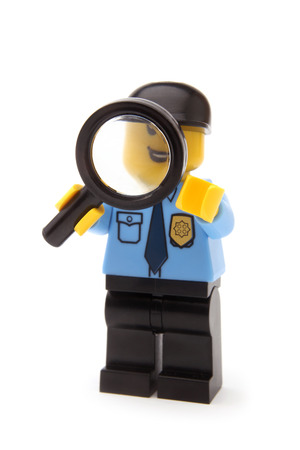 little man: ST. PETERSBURG, RUSSIA - November 15, 2015: A studio shot of a Police Officer Lego minifigure, Lego is a line of plastic construction toys that are manufactured by The Lego Group Editorial