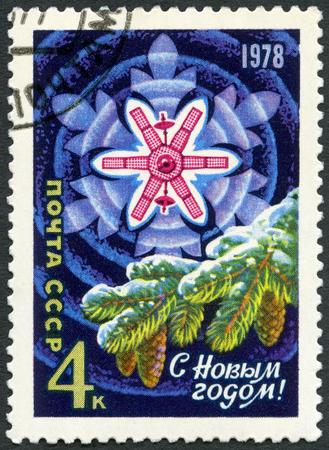 postage stamp: USSR - CIRCA 1977: A stamp printed in USSR shows Fir, Snowflake, Molniya Satellite, devoted New Year 1978, circa 1977