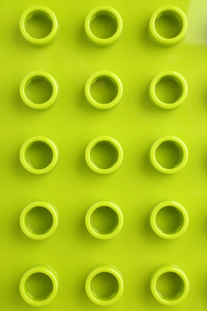 coloured background: Green plastic construction baseplate, for backgrounds or textures Stock Photo