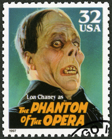 screenwriter: UNITED STATES OF AMERICA - CIRCA 1997: A stamp printed in USA shows portrait of Leonidas Frank Lon Chaney (1883-1930) as The Phantom of the Opera, series Classic Movie Monsters, circa 1997