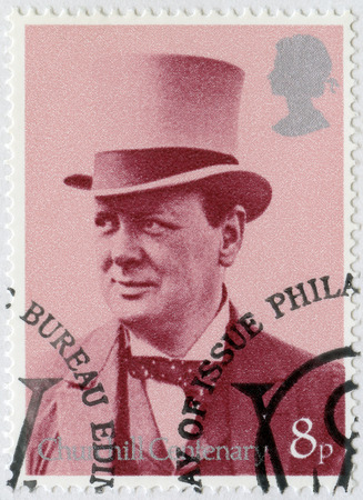 winston: UNITED KINGDOM - CIRCA 1974: A stamp printed by United Kingdom shows Sir Winston Spencer Churchill (1874-1965), with top hat, as Secretary of War and Air, 1919, politician, circa 1974