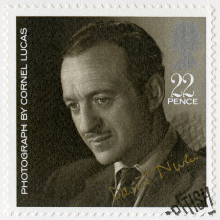 movie star: GREAT BRITAIN - CIRCA 1985: A stamp printed in Great Britain shows David Niven (1910-1983), by Cornel Lucas, series 20th Centenary Stars and Directors of Film, circa 1985