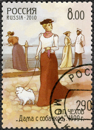 dramatist: RUSSIA - CIRCA 2010: A stamp printed in Russia shows The Lady with the Dog, dedicated the 150th anniversary of birth of Anton Chekhov (1860-1904), writer, circa 2010