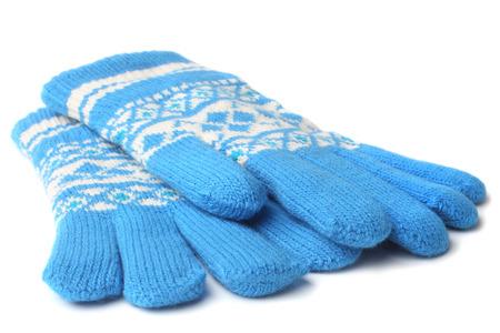 guantes: Cálidos guantes de lana de punto en el fondo blanco