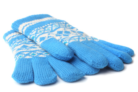 spliced: Warm woolen knitted gloves on white background Stock Photo