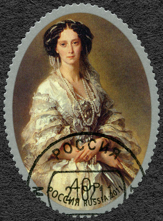 postage: RUSSIA - CIRCA 2011: A stamp printed in Russia shows Empress Maria Alexandrovna  (1824-1880), portrait by Franz Xaver Winterhalter, dedicated the joint issue the Russia - Aland Islands (Finland), the 150th anniversary of foundation of Mariehamn, circa 201