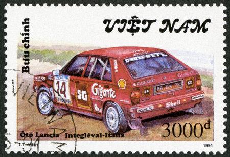 italia: VIETNAM - CIRCA 1991: A stamp printed in Vietnam shows Lancia Italia, series Rally Cars, circa 1991 Editorial