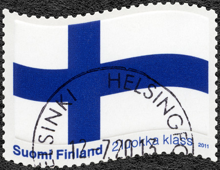 philatelist: FINLAND - CIRCA 2011: A stamp printed in Finland shows the Finnish flag, the Blue Cross flag, circa 2011