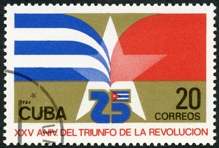 CUBA - CIRCA 1984: A stamp printed in Cuba shows flag of Cuba, dedicated 25th anniversary of the Revolution, circa 1984 Redakční
