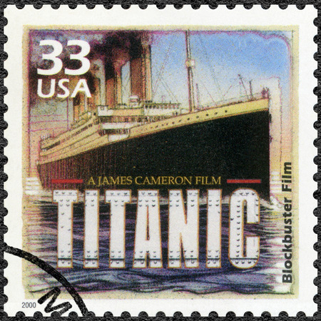 blockbuster: UNITED STATES OF AMERICA - CIRCA 2000: A stamp printed in USA shows Poster for Titanic, 1997, devote blockbuster film, series Celebrate the Century, 1990s, circa 2000 Editorial