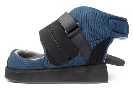 Post operative heel off-loading shoe on white background