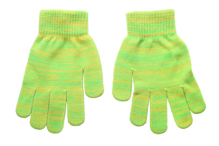 frost bound: Warm woolen knitted gloves isolated on white background