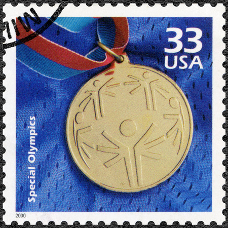 retardation: UNITED STATES OF AMERICA - CIRCA 2000: A stamp printed in USA shows Olympic gold medal, devote Special Olympic, series Celebrate the Century, 1990s, circa 2000 Editorial
