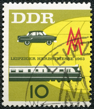 publicize: GERMAN DEMOCRATIC REPUBLIC - CIRCA 1963: A stamp printed in GDR Germany shows car and train, Issued to publicize the 1963 Leipzig Fall Fair, circa 1963