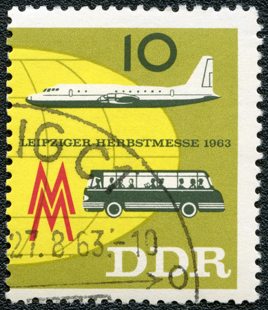 publicize: GERMAN DEMOCRATIC REPUBLIC - CIRCA 1963: A stamp printed in GDR Germany shows plane and bus, Issued to publicize the 1963 Leipzig Fall Fair, circa 1963