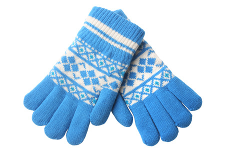 Warm woolen knitted gloves isolated on white background