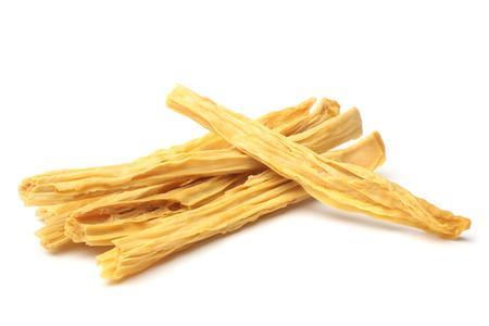 Dried yuba sticks or Fuzhu on white background Standard-Bild