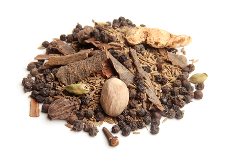 barks: Whole garam masala on white background