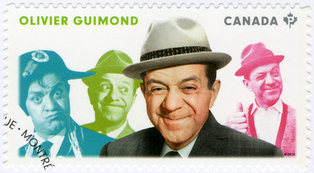 canada stamp: CANADA - CIRCA 2014: A stamp printed in Canada shows Olivier Guimond (1914-1971), actor, series Great Canadian Comedians, circa 2014