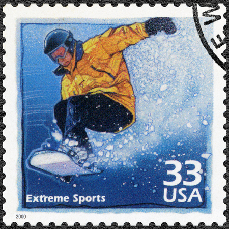 popularity: UNITED STATES OF AMERICA - CIRCA 2000: A stamp printed in USA shows Snowboarder, increased popularity in extreme sports, series Celebrate the Century, 1990s, circa 2000 Editorial