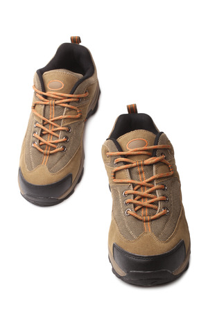 shoestrings: Hiking boots on white background
