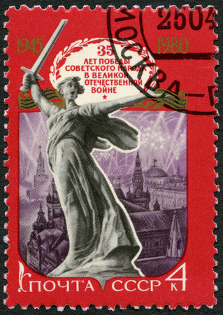 postmail: USSR - CIRCA 1980: A stamp printed in USSR shows the sculpture Motherland in Stalingrad and Fireworks over Moscow,35th anniversary of victory in World War II, circa 1980 Editorial