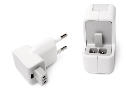 replaceable: USB wall charger with removable plug on white background Stock Photo