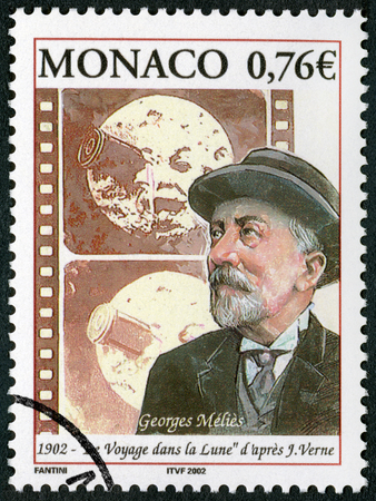 filmmaker: MONACO - CIRCA 2002: A stamp printed in Monaco shows Marie Georges Jean Melies (1861-1938), filmmaker, A Trip to the Moon (1902), circa 2002 Editorial
