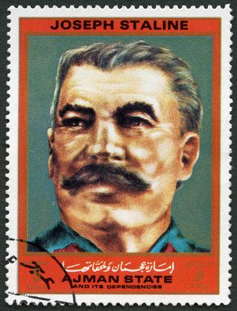 totalitarian: AJMAN - CIRCA 1972: A stamp printed in Ajman shows Joseph Vissarionovich Stalin Jughashvili (1878-1953), series Figures from the Second World War, circa 1972