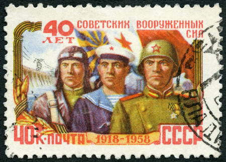 airman: USSR - CIRCA 1958: A stamp printed in USSR shows Airman, sailor and soldier, series 40th anniversary of Red Armed Forces, circa 1958