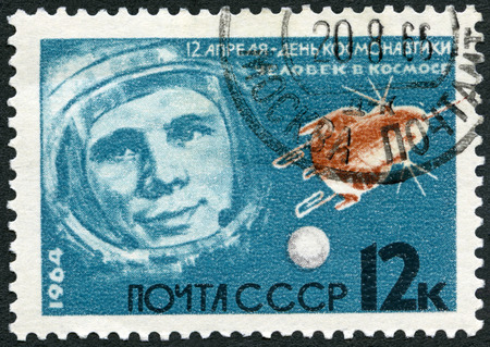 USSR - CIRCA 1964: A stamp printed in USSR shows Portrait of Yuri Gagarin (1934-1968) and stellite, series Leaders in rocket theory and technique, circa 1964