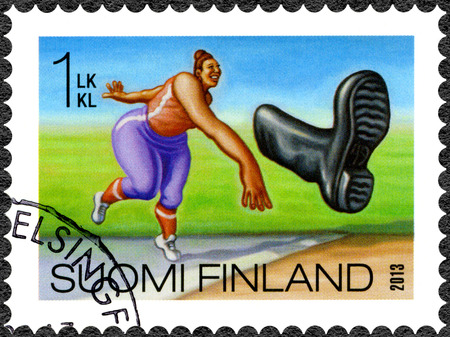 oddity: FINLAND - CIRCA 2013: A stamp printed in Finland shows boot throwing, series Finnish Oddity, circa 2013