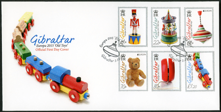 old toys: GIBRALTAR - CIRCA 2015: A stamp printed in Gibraltar shows toys, series Europa Old Toys, circa 2015
