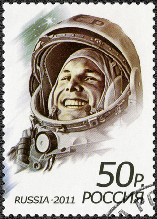 spaceflight: RUSSIA - CIRCA 2011: A stamp printed in Russia shows first man in space, Yuri Alekseyevich Gagarin (1934-1968), the 50th anniversary of the first human spaceflight, circa 2011