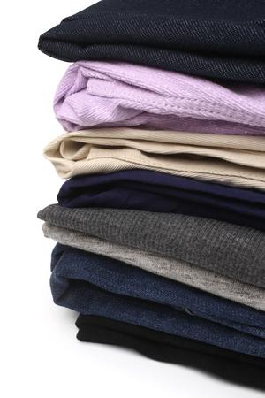 folded: Folded clothes on white background Stock Photo