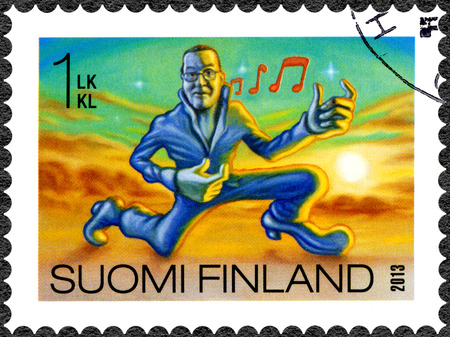 oddity: FINLAND - CIRCA 2013: A stamp printed in Finland shows air guitar, series Finnish Oddity, circa 2013