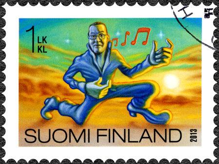 FINLAND - CIRCA 2013: A stamp printed in Finland shows air guitar, series Finnish Oddity, circa 2013