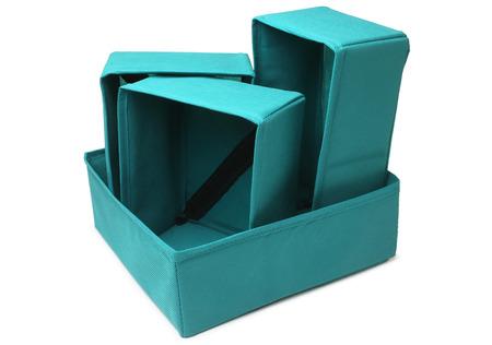storage: Set of textile storage boxes on white background