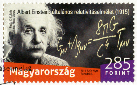 physicist: HUNGARY - CIRCA 2015: A stamp printed in Hungary shows Albert Einstein (1879-1955), physicist, The 100th Anniversary of the presented the general theory of relativity, circa 2015 Editorial