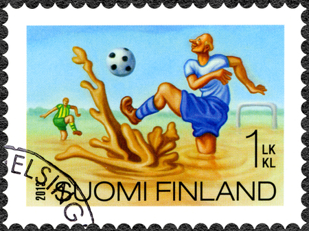 oddity: FINLAND - CIRCA 2013: A stamp printed in Finland shows swamp football, series Finnish Oddity, circa 2013