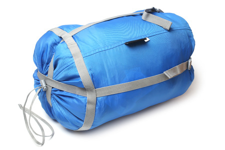 tightness: Tourist sleeping bag in a compression bag on white background