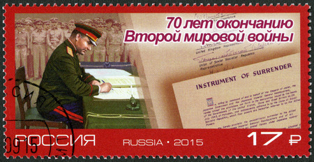 a battleship: RUSSIA - CIRCA 2015: A stamp printed in Russia depicts Lieutenant-General Kuzma Derevyanko during the signing of the Instrument of the Japanese surrender on board of the Missouri US battleship in Tokyo Bay, The 70th Anniversary of the End of World War I