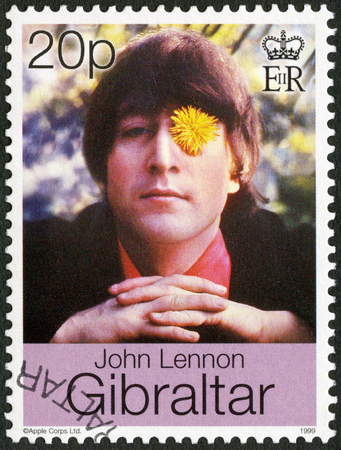 postage stamp: GIBRALTAR - CIRCA 1999: A stamp printed in Gibraltar shows John Winston Ono Lennon (1940-1980), singer and songwriter, circa 1999