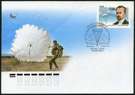back pack: RUSSIA - CIRCA 2012: A stamp printed in Russia shows inventor G.E. Kotelnikov, devoted the 100th anniversary of the testing day of a back pack parachute, circa 2012