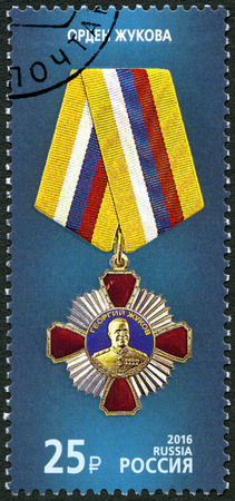 RUSSIA - CIRCA 2016: A stamp printed in Russia shows Order of The Order of Zhukov on the blue background, series State awards of the Russian Federation, circa 2016 Editorial