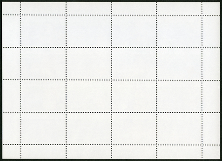 blanked: Blank postage stamp sheet on black background Stock Photo